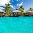 Over water bungalows with steps into amazing lagoon — Stock Photo #9650791
