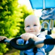 Close up of a happy child sitting on bicycle - 