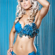 Young sexy woman in blue diamnods and feathers bikini — Foto Stock