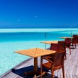 Tables and chairs at tropical beach restaurant — Stock Photo
