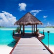 Jetty with ocean view on tropical island - Stock Photo