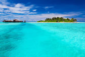 Tropical Island and over water bungalows — Stock Photo
