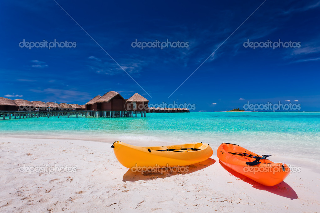 Two colourful kayaks on the tropical beach  Stock Photo #9650877