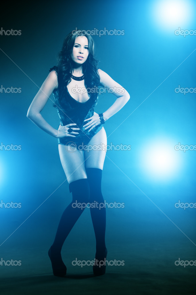 Young female in attractive high fashion black clothes with stockings — Stock Photo #9650932