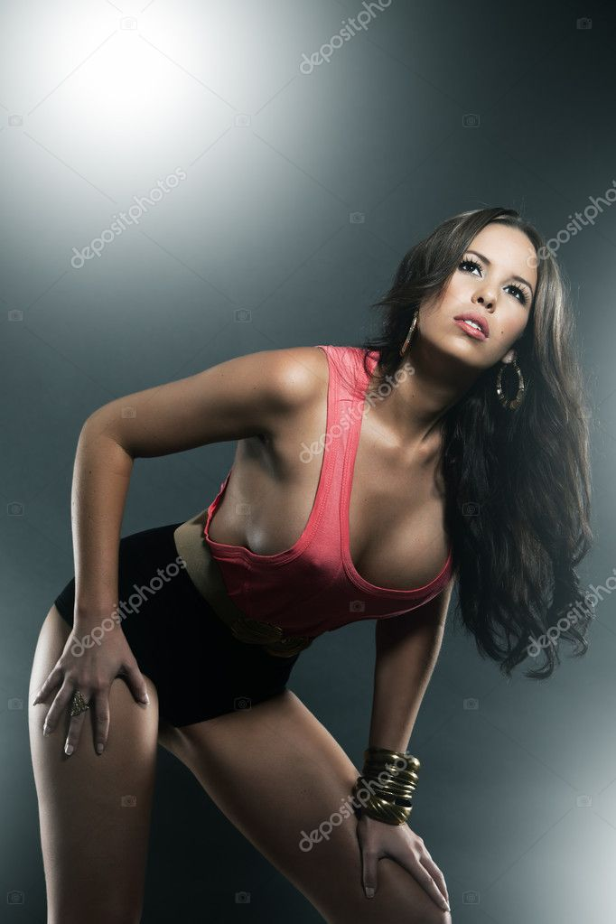 Slim gorgeous female model in sexy red singlet  Stock Photo #9650944