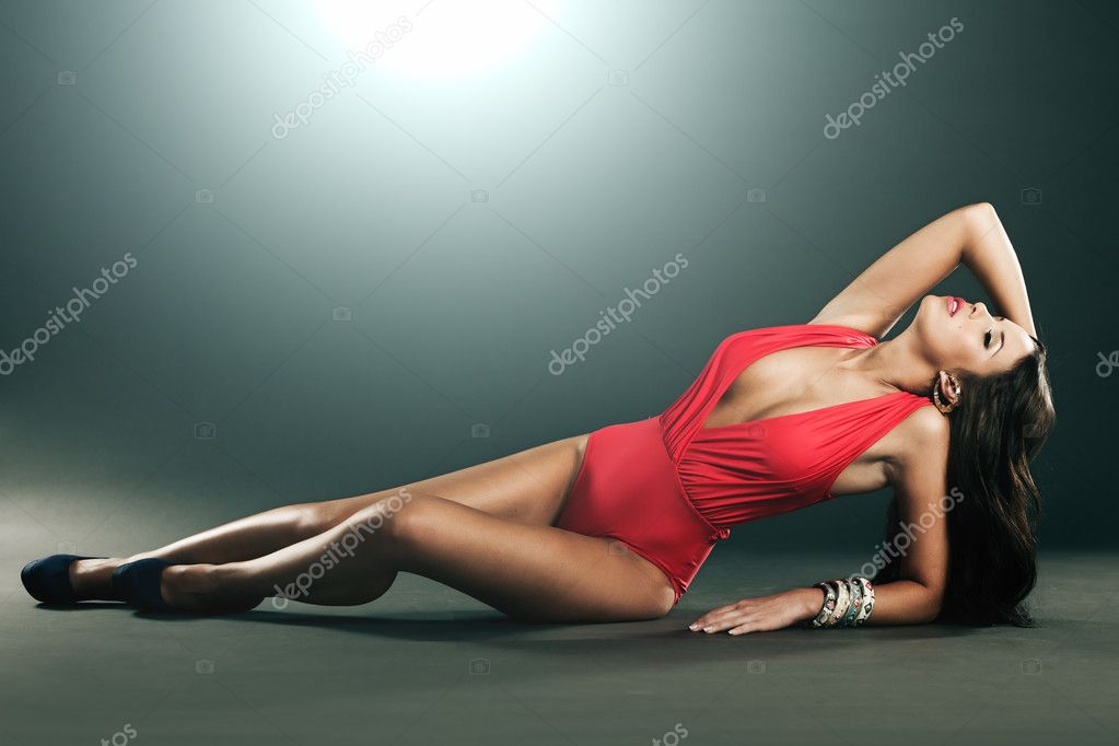 High fashion shot of attractive woman in single piece red lingerie — Stock Photo #9650973