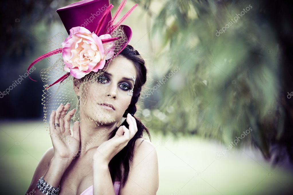 Face of young beautiful woman in a vintage hat outdoors — Stock Photo #9651167