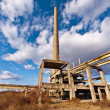 Stock Photo: Tower of an industrial complex in degradation