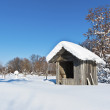 Landscape with a hut covered with snow — Stock Photo