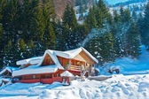 Mountain chalet covered snow in winter — Stock Photo
