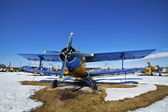 Old airplanes parked on a meadow with snow — Stock Photo