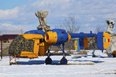 Helicopter stationed in winter on a snow covered field — Stock Photo