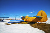 Old airplanes parked on a meadow with snow — 图库照片