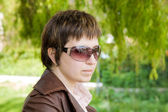 Young woman in shades — Stock Photo