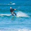 CORRALEJO, SPAIN - APRIL 28: Kitesurfer enjoys perfect wind and — Stock Photo