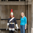 Tourist is photographed next to Horse Guard on centry duty, London, UK — Photo