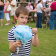 Cute little boy with huge blue candyfloss at a local village fet — Stock Photo #10388423