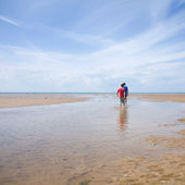 Two boys paddling in low tide, Norfold, UK — Stock Photo
