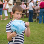 Cute little boy with huge blue candyfloss at a local village fet — Stock Photo