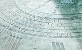 """Part of an old sundial with word """"natural"""" sharply in focus — Stock Photo"""