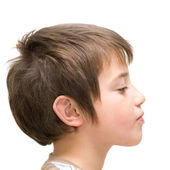 Haughty face; little boy poses against white background — Stock Photo