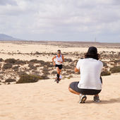 CORRALEJO - OCTOBER 30: Roger Roca leads and wins the men race a — 图库照片