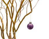 Christmas table decoration with salix branch and a bauble in a v — Stock Photo