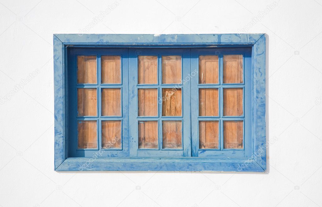 Architectural detail - faded blue window in a whitewashed wall; old spanish town (Canary islands) — Stock Photo #8160121