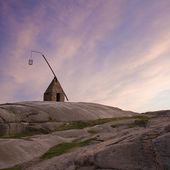 Amazing sunset at southern Norway, old lighthouse against the sk — Foto de Stock