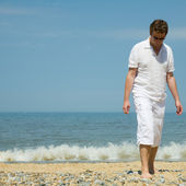 Handsome middle aged man by seaside — Stock Photo