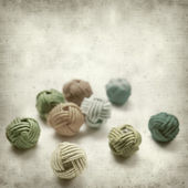 Textured old paper background with beads in knotted style — Stock Photo