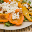 Summer light meal -- fried sweet pepper with garlic and crumbled feta cheese, on a bed of rocked salad — Stock Photo #9538523