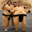 Постер, плакат: CORRALEJO MARCH 17: Dressed up participants Sumo wrestlers
