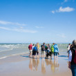 GRENEN, DENMARK - AUGUST 26: Tourists walk up to the end of Gren - Stock Photo
