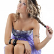 Girl sitting with funny expression, pulling hair. — Stock Photo #8575499