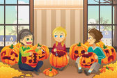 Kids carving pumpkins — Stock Vector