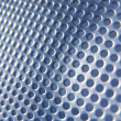 Faded Blue Metal Holes — Stock Photo
