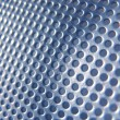 Stock Photo: Faded Blue Metal Holes