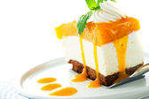 A piece of mango cheese cake on white background as a studio sho — Stock Photo