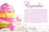 Cupcake and decorating bag on a white table with colorful sugar — Foto de Stock
