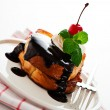 Stock Photo: French toast with dark chocolate, white cream, red cherry and a