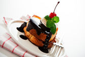 French toast with dark chocolate, white cream, red cherry and a — Stock Photo