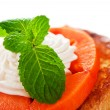 Two slices of french toast with papaya, cream and mint leaf on a — Stock Photo