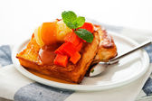 Two slices of french toast with papaya, vanilla ice cream, caram — Stock Photo