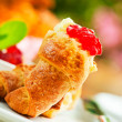 Outdoor breakfast with fresh croissant coffee, jam and flowers a - Stock Photo