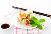 Vegetarian spring roll with carrot, soy sprouts and shrimp on wh — Stock Photo