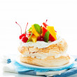 Pavlova with fresh fruit (mango, pineapple, watermelon, cherry) — Stock Photo