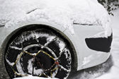 Snow covered car in the street — Stock Photo