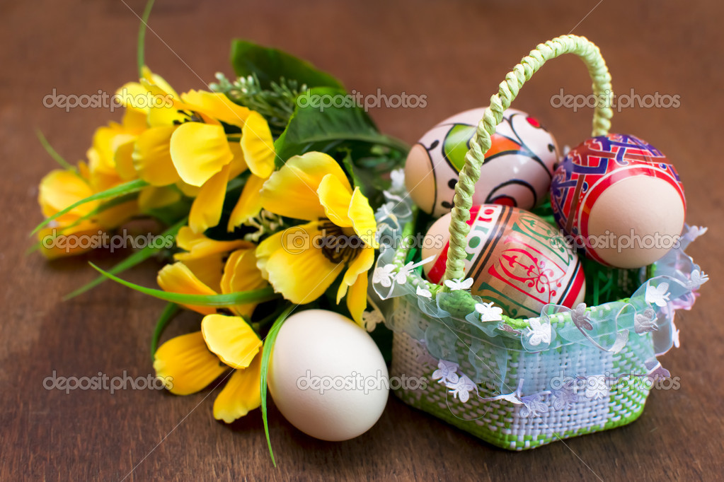 Easter eggs in basket on wooden background  Stock Photo #9872046