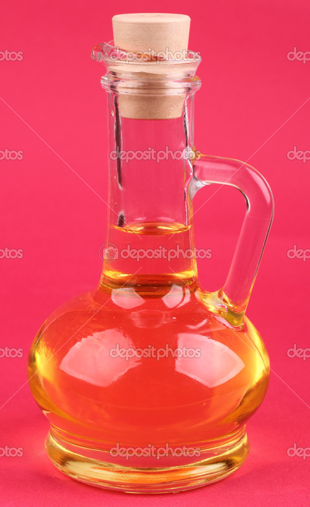 Lovely glass jug with oil over bright background on Food theme — Stock Photo #10151669